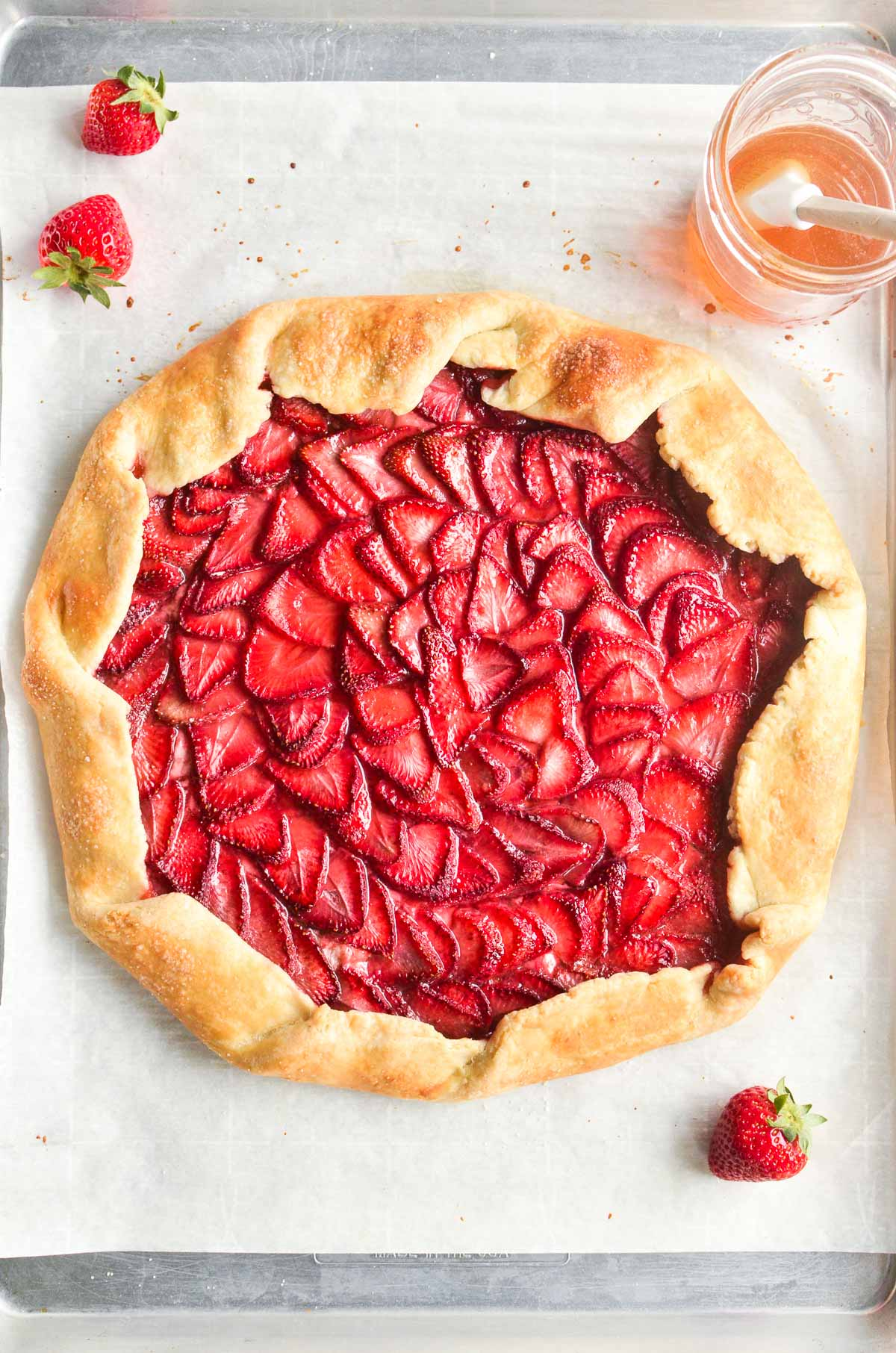 a strawberry galette on a baking pan