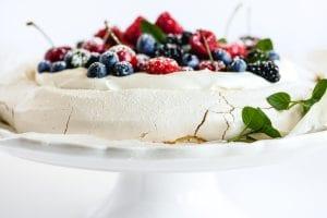 berry pavlova on a cake stand