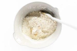 adding flour to shortbread dough