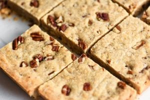 slicing butter pecan shortbread into squares