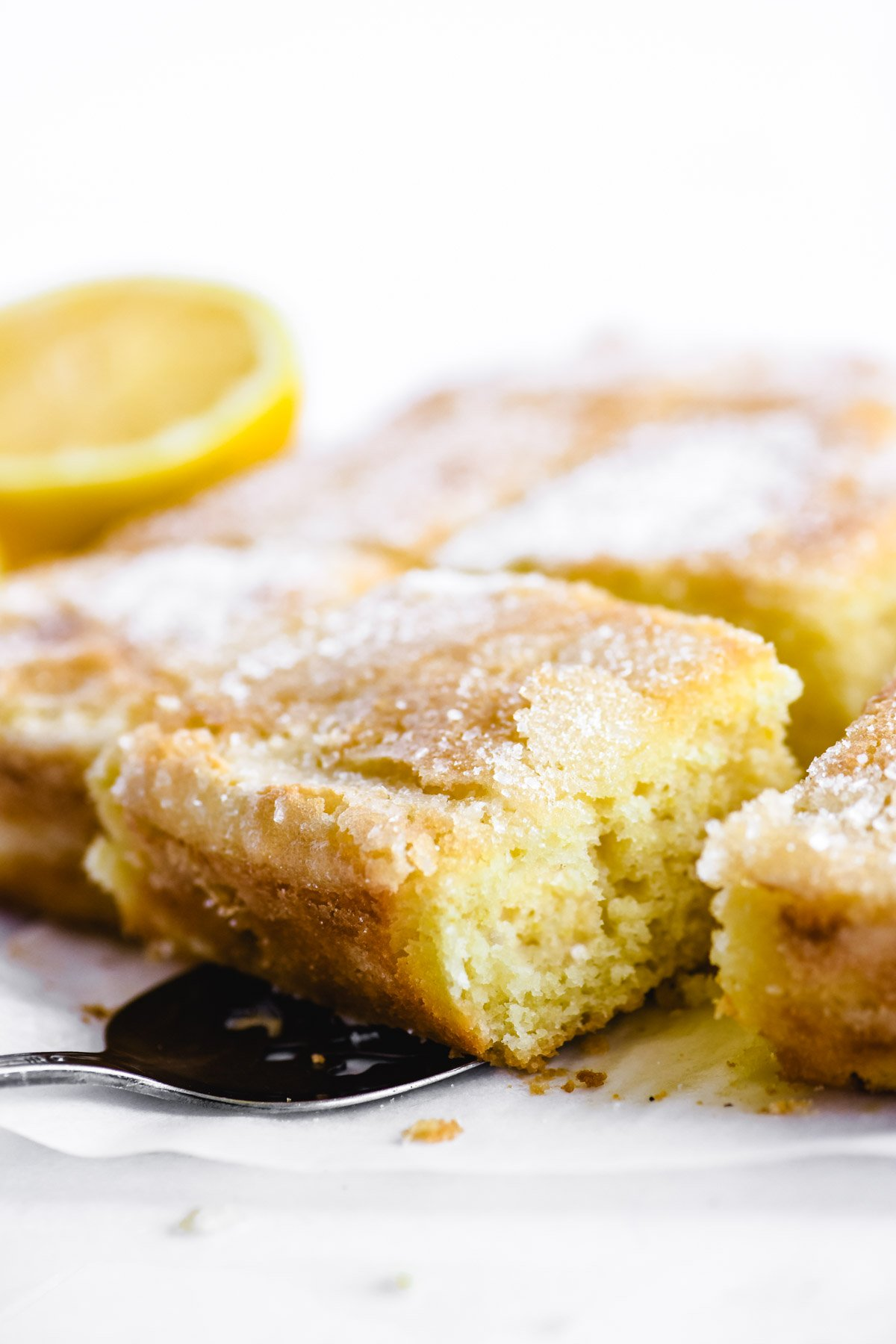 taking a slice of lemon crunch cake with a cake server