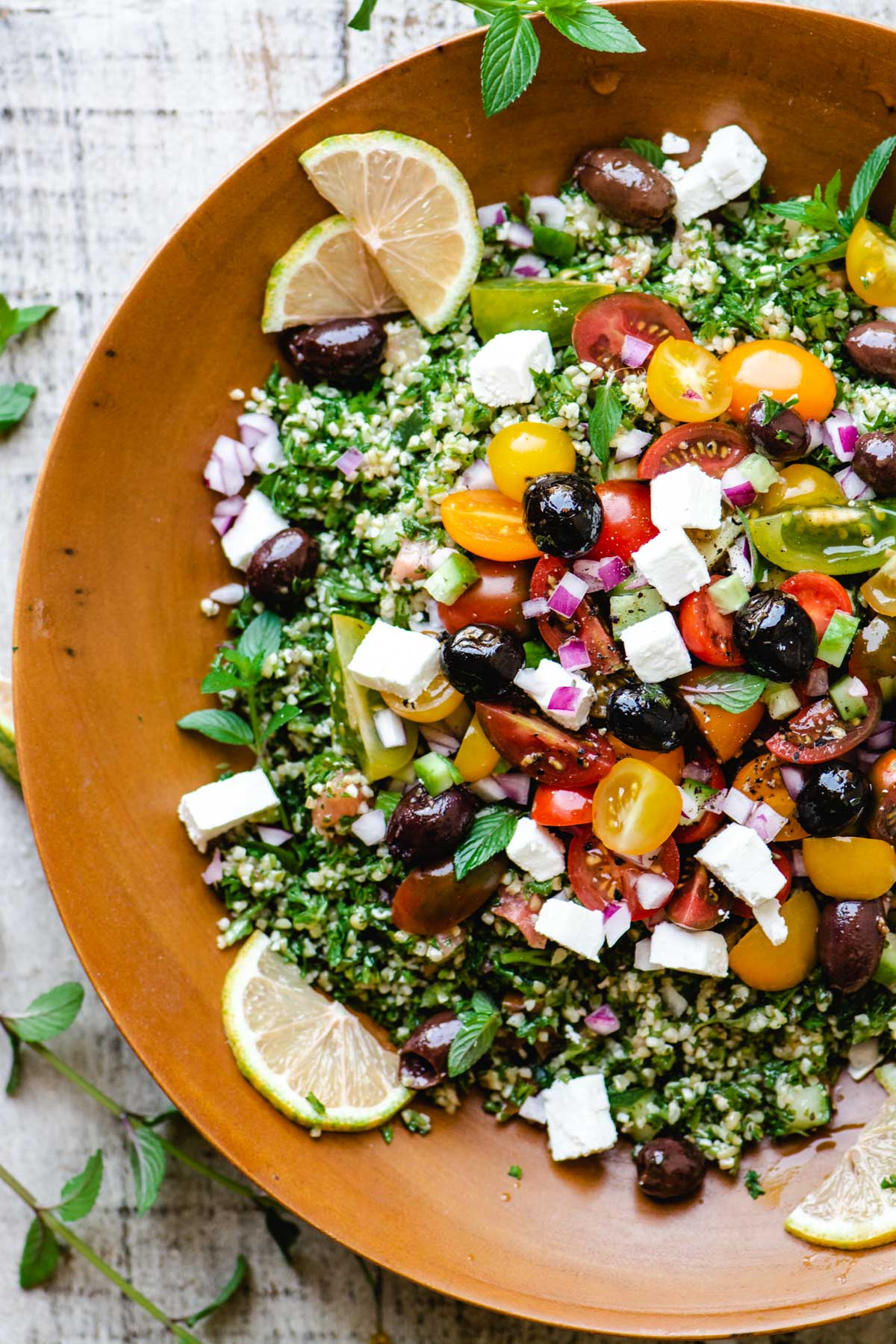tabbouleh salad with colorful toppings