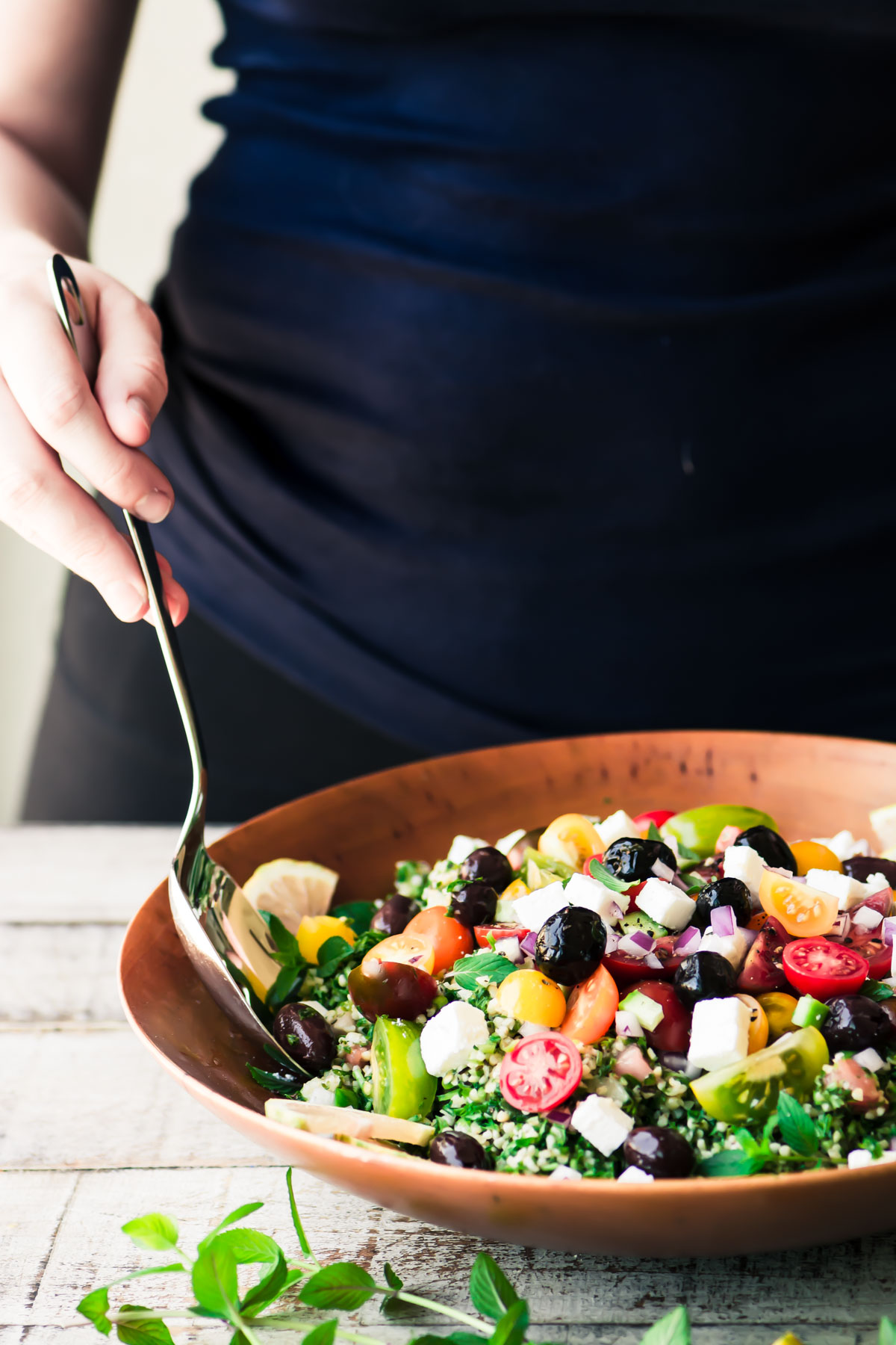 tossing a tabbouleh salad
