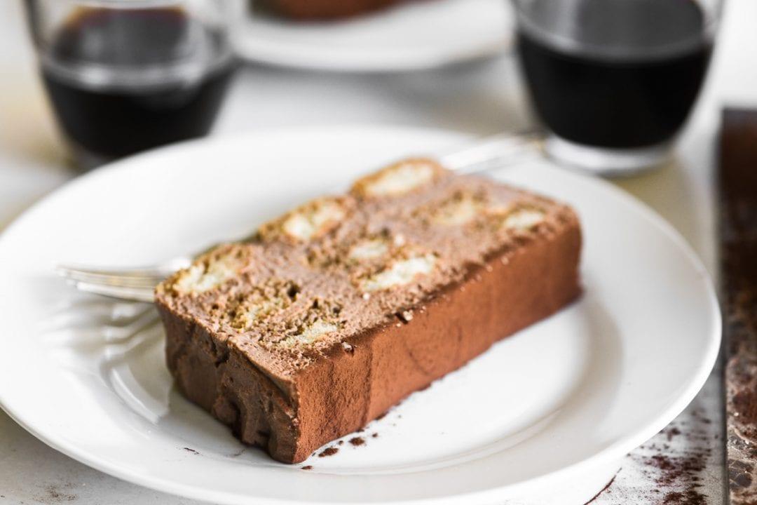 a slice of Nutella Tiramisu cake on a white plate