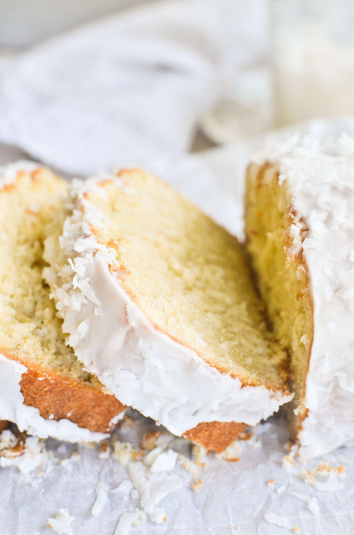 a glazed coconut pound cake on parchment paper