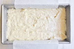 coconut cake batter in loaf pan