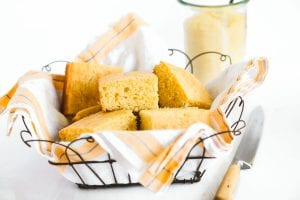 cornbread cut into squares in a basket