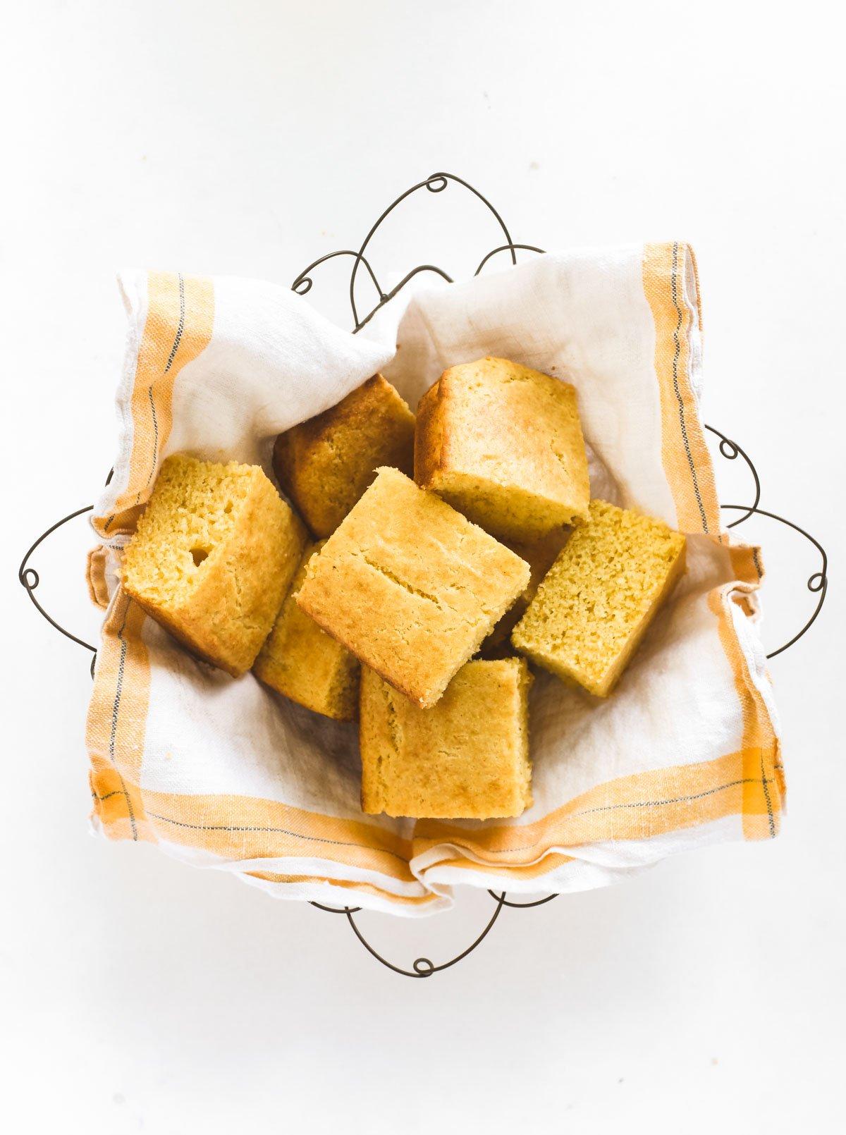 A basket of cornbread pieces.