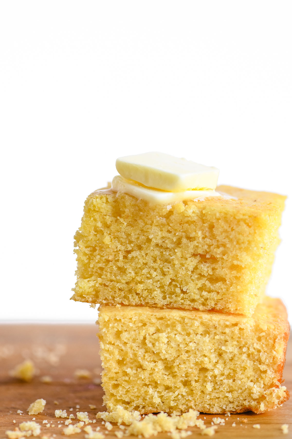 A stack of cornbread with melting butter.
