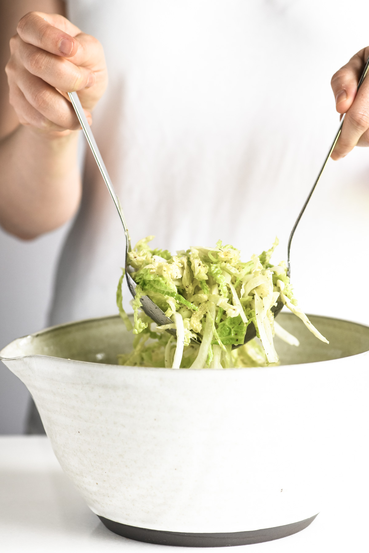 tossing vinegar based coleslaw