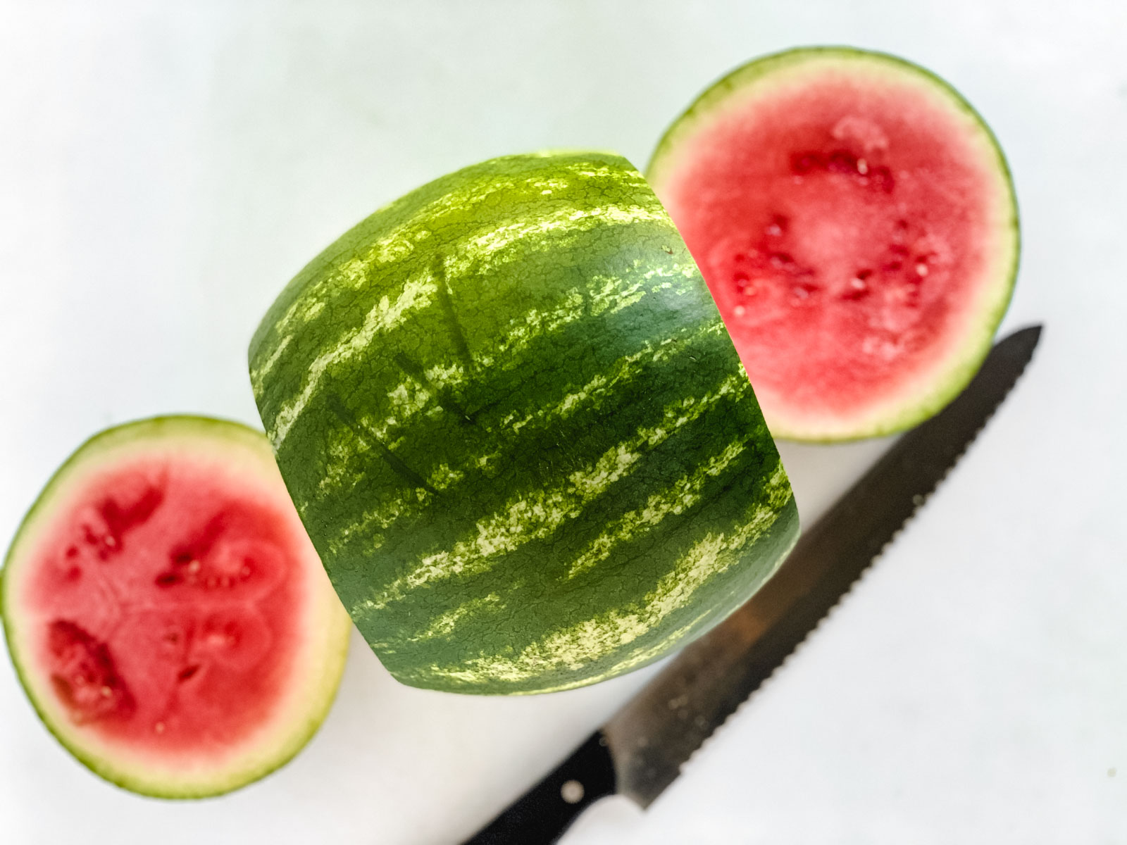 slicing off ends of a watermelon