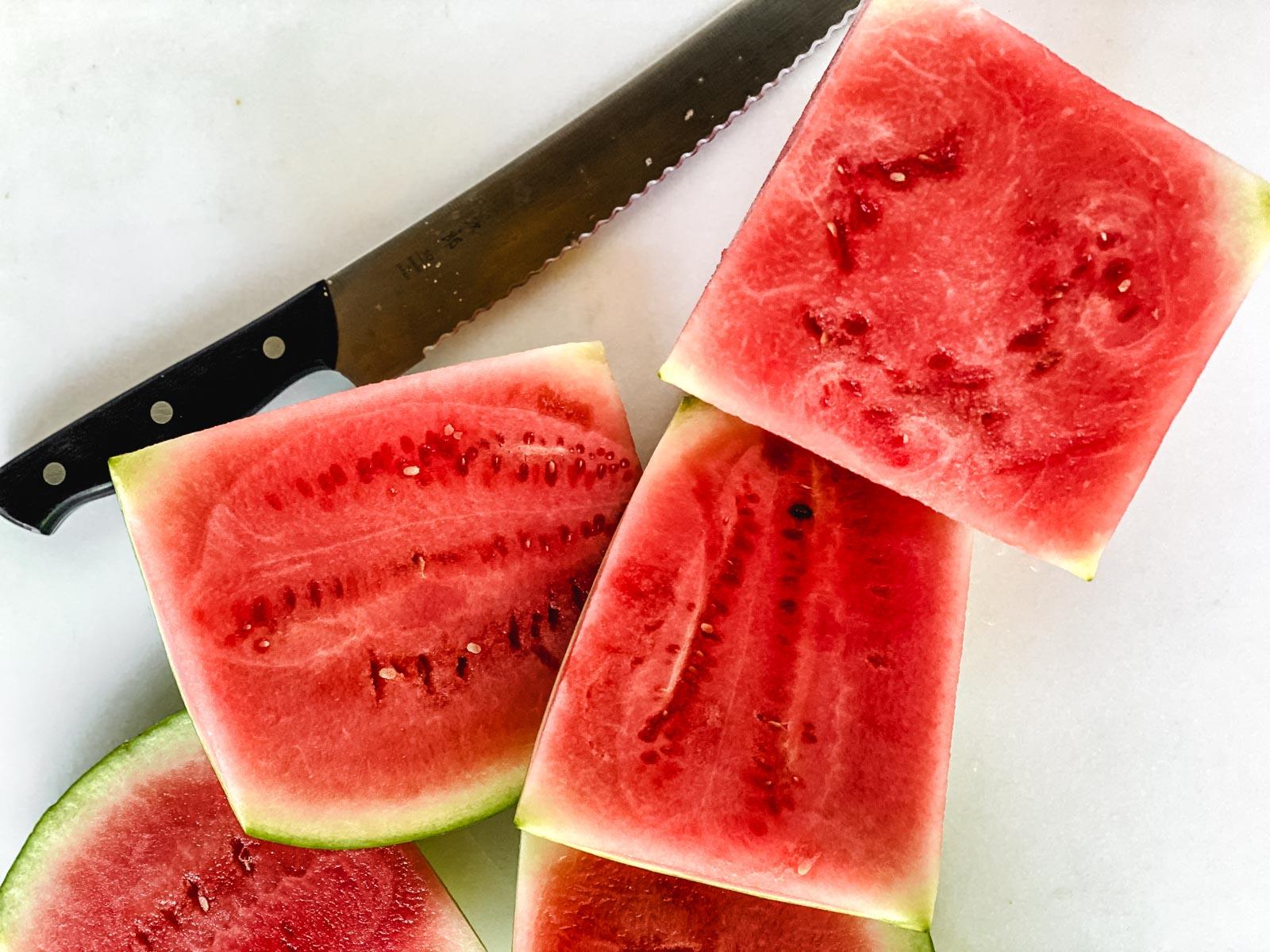 slicing rind off watermelon