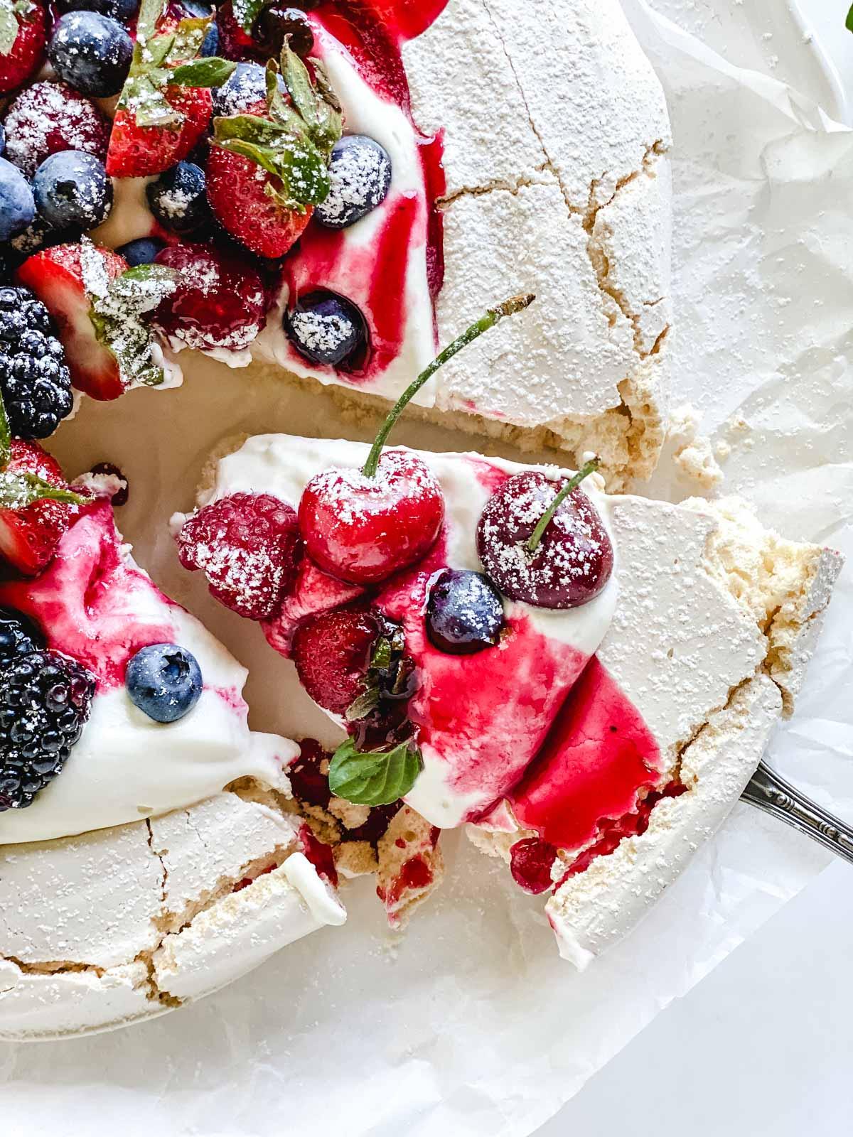 serving a summer berry pavlova