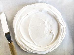 egg whites shaped into a disk for pavlova