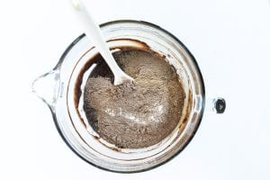 Adding dry ingredients to brownie batter