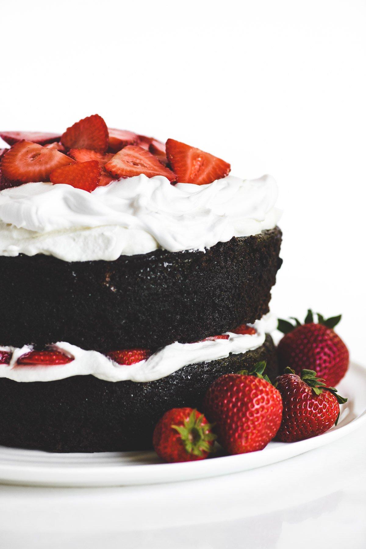 chocolate Strawberry Whipped Cream Cake with fresh berries