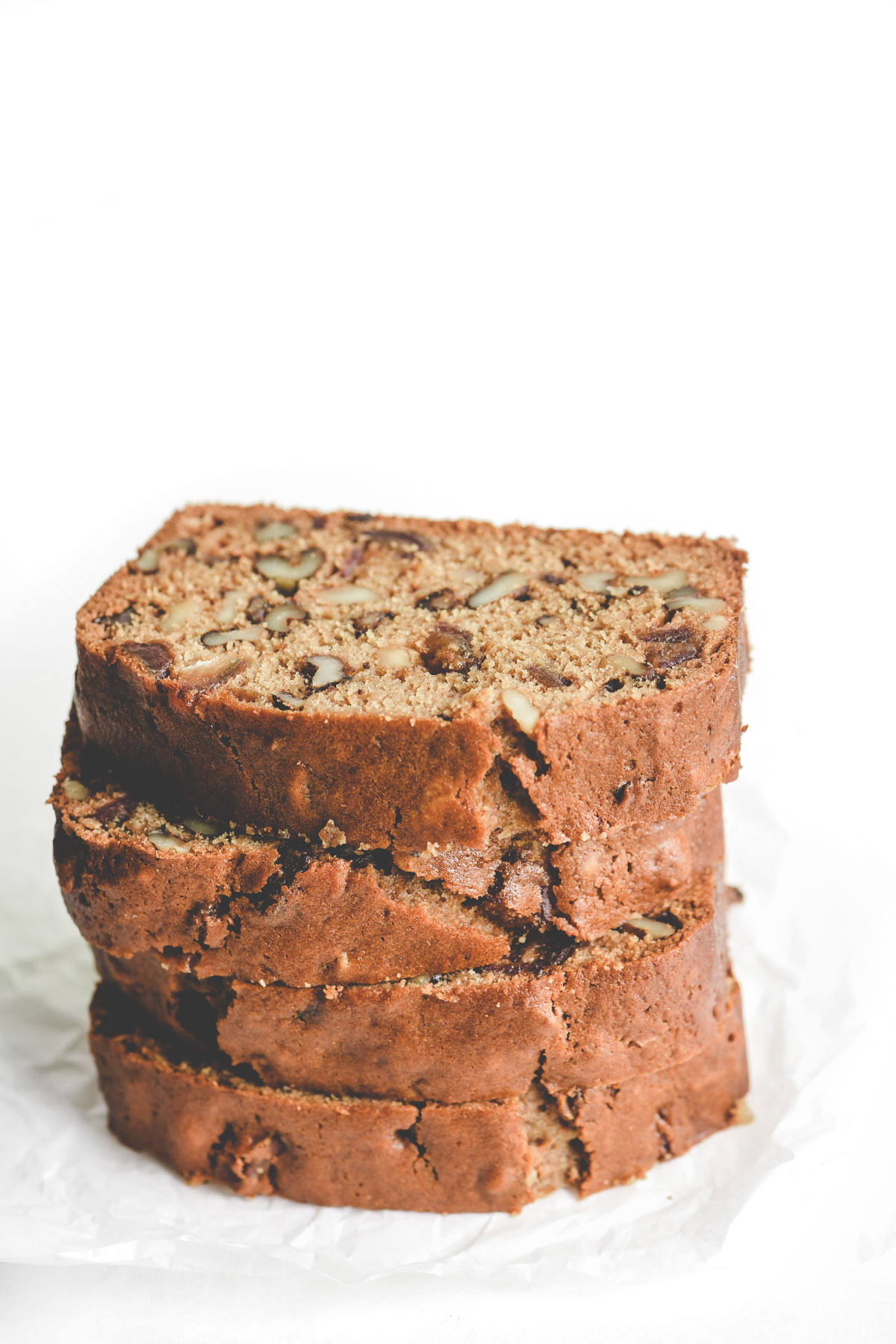 a stack of slices of date nut bread