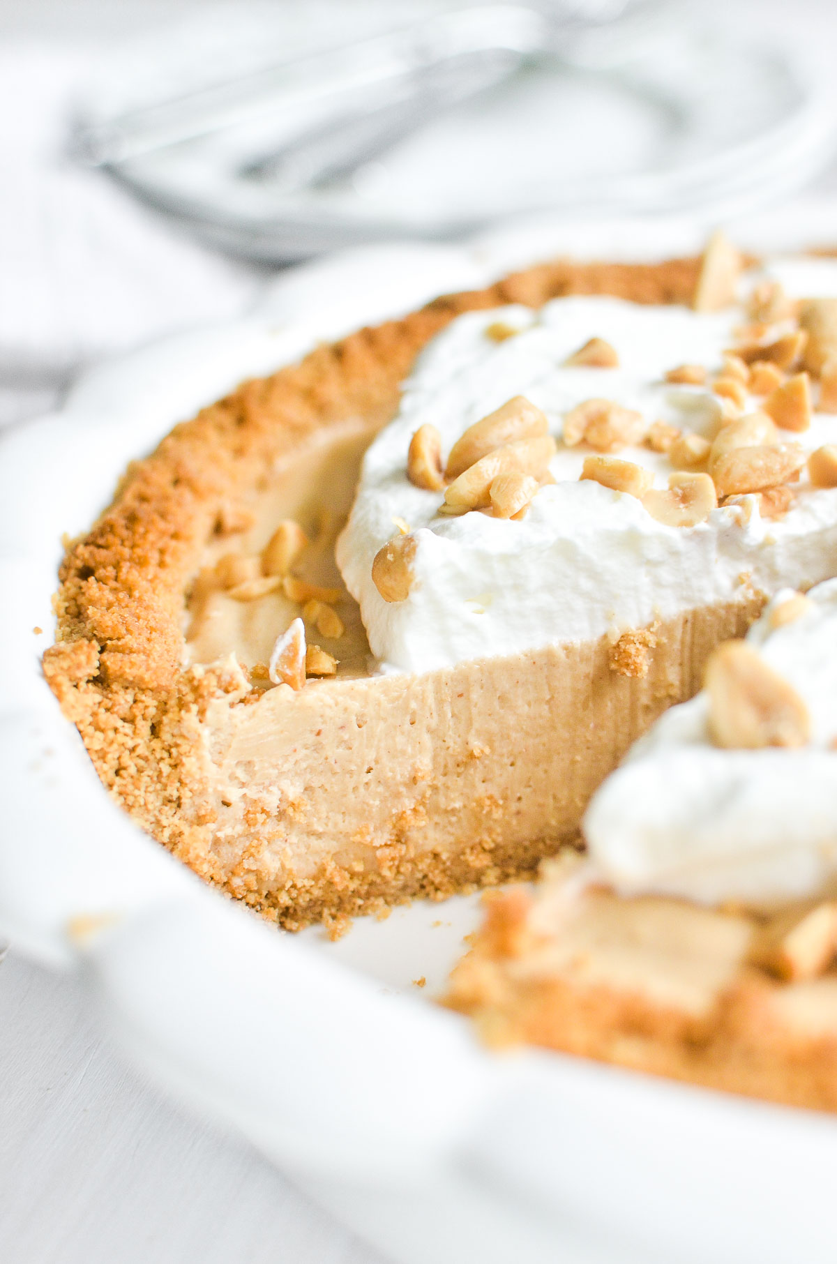peanut butter pie topped with whipped cream