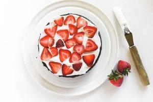 layering a chocolate strawberry cake