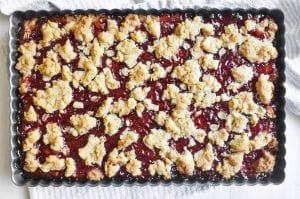 Strawberry jam crumble bars, baked.