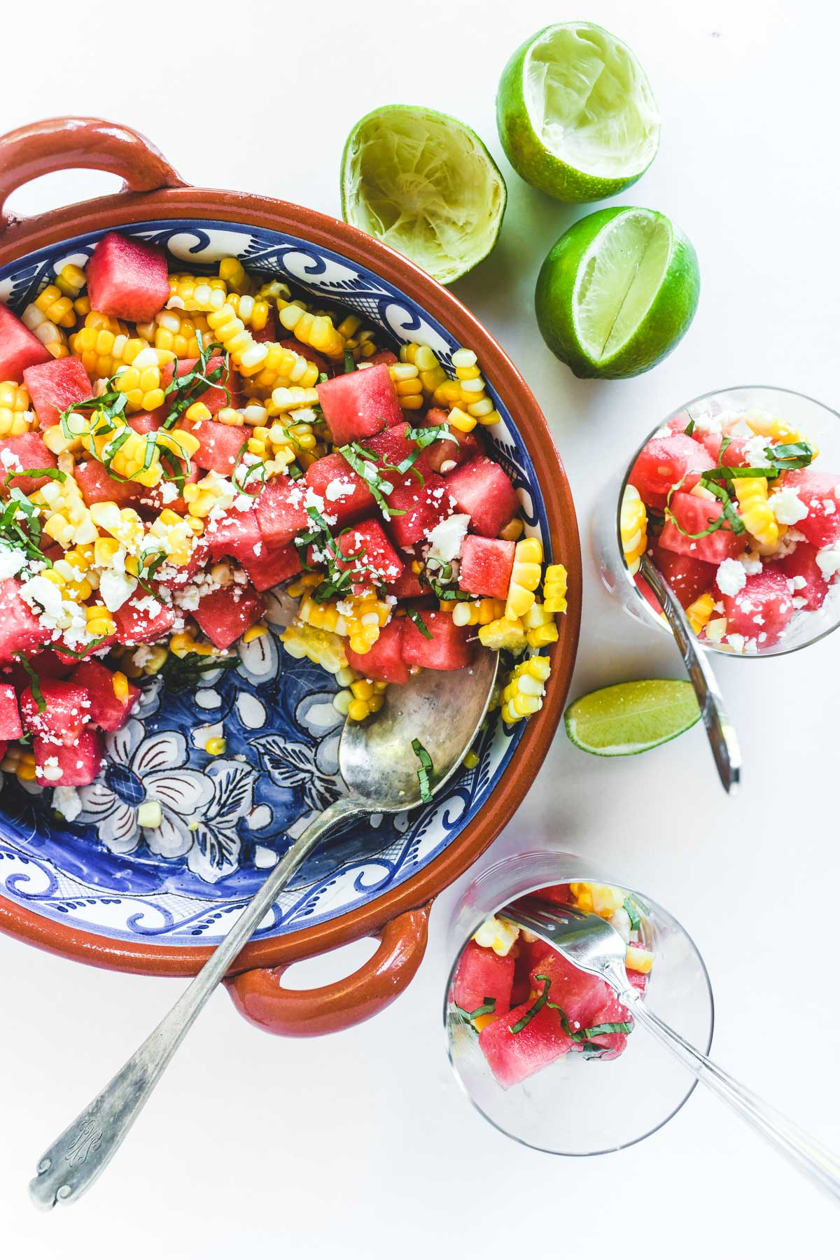 corn and watermelon salad with glasses and limes