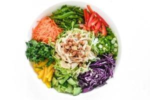 Thai chicken salad ingredients in a bowl