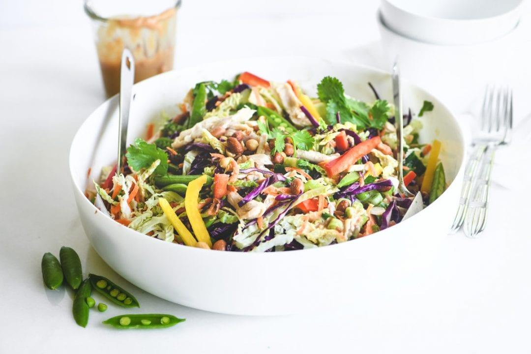 Thai chicken salad with jar of dressing