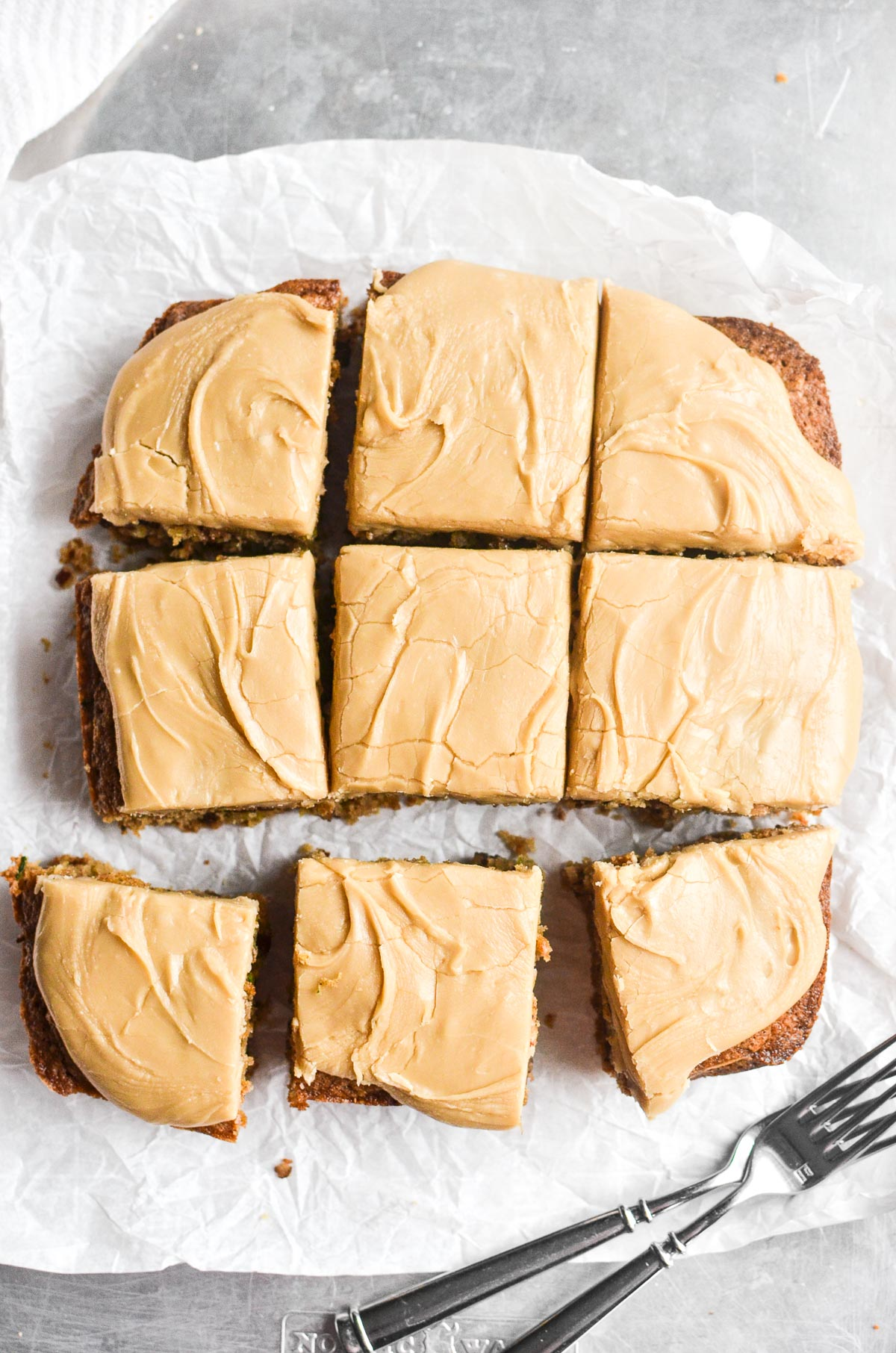 caramel frosted zucchini bars on parchment paper