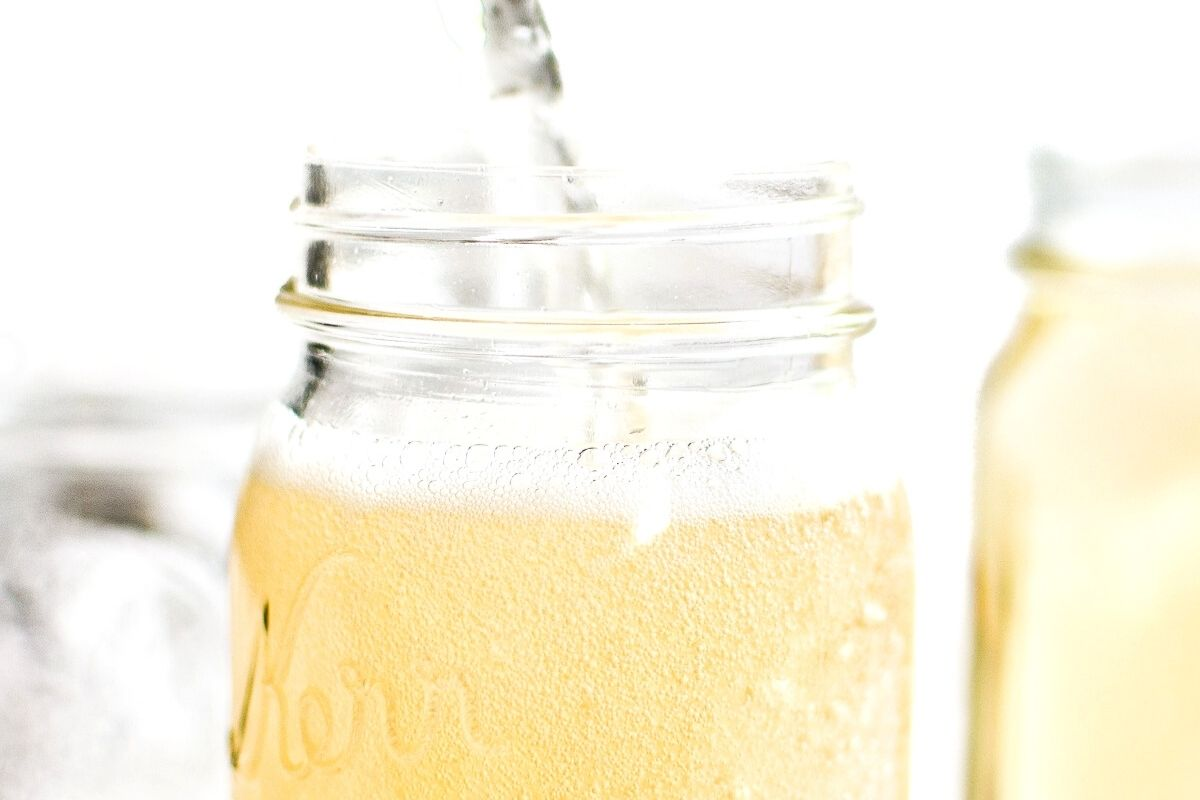 pouring homemade cream soda