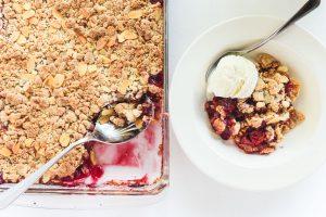 easy cherry almond crisp, in pan with ice cream