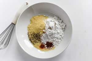 making cornmeal crust mixture for fried green tomatoes