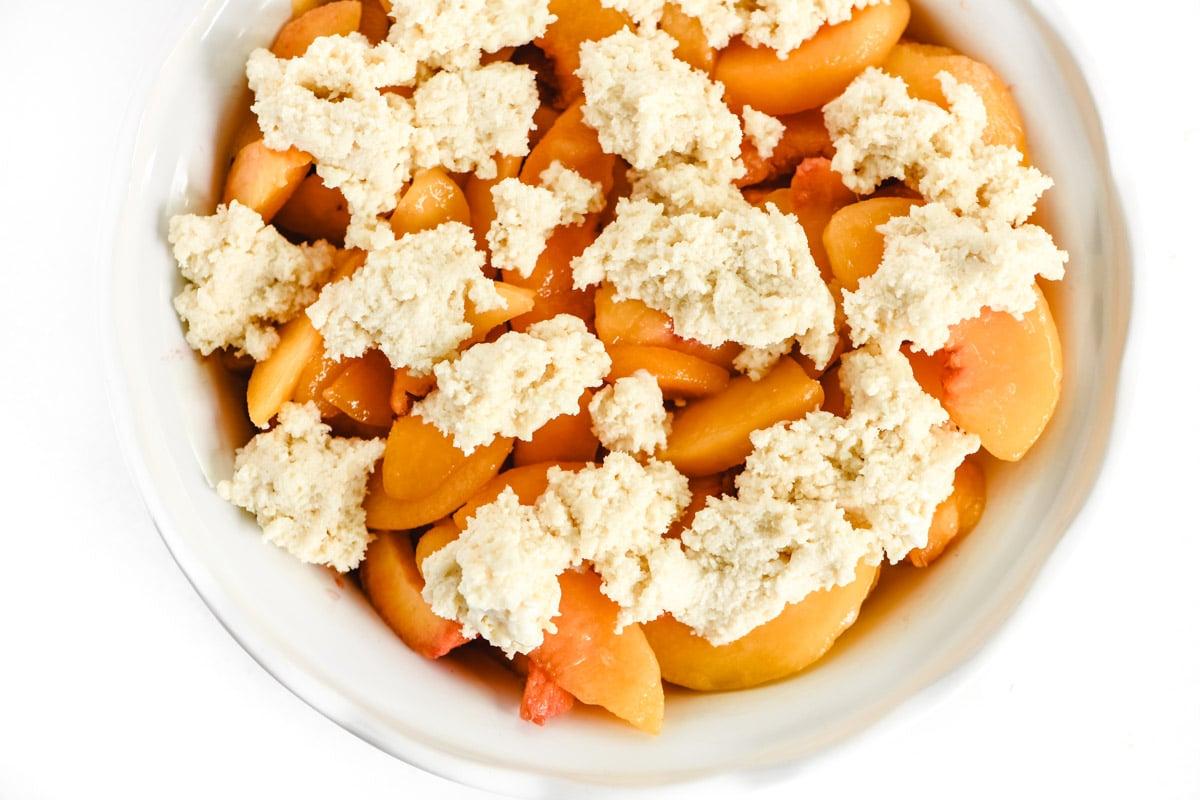 cobbler dough on peaches