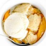 peach cobbler with a scoop of ice cream