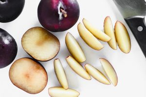 slicing plums