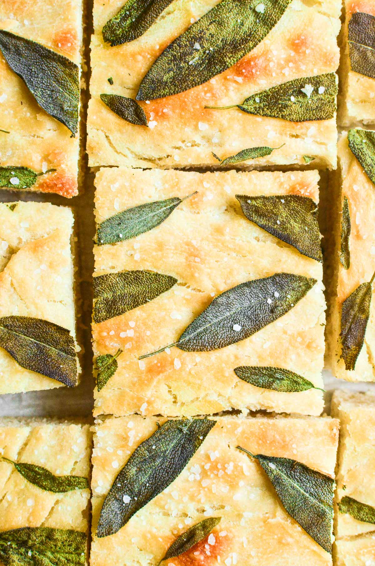 slices of sage focaccia, topped with fresh sage leaves