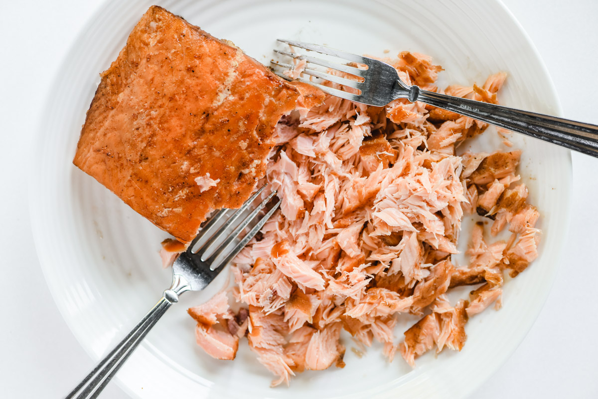 flaking a piece of smoked salmon