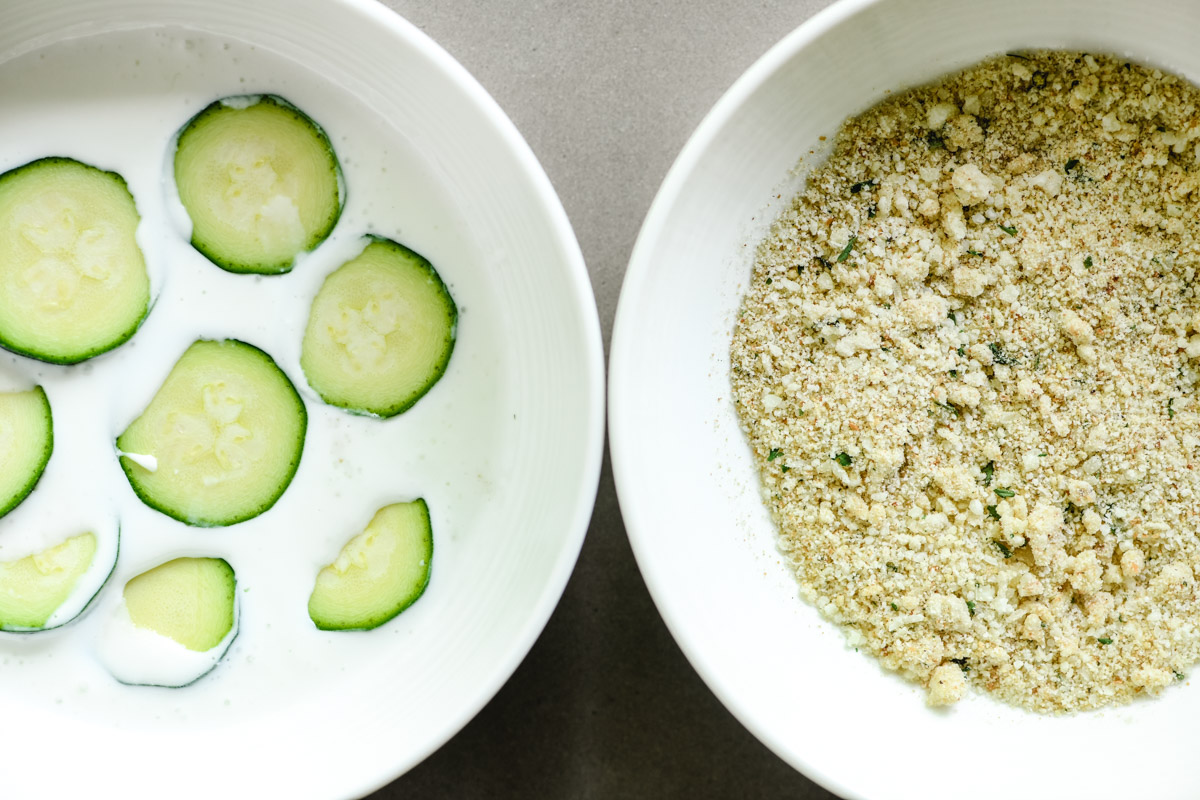 coating zucchini with buttermilk and breadcrumbs