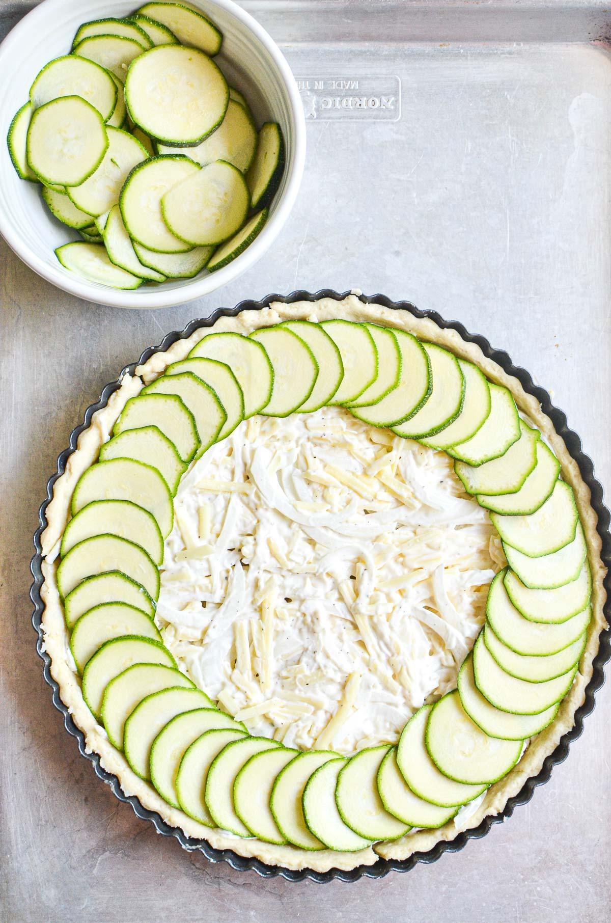 assembling a zucchini pie