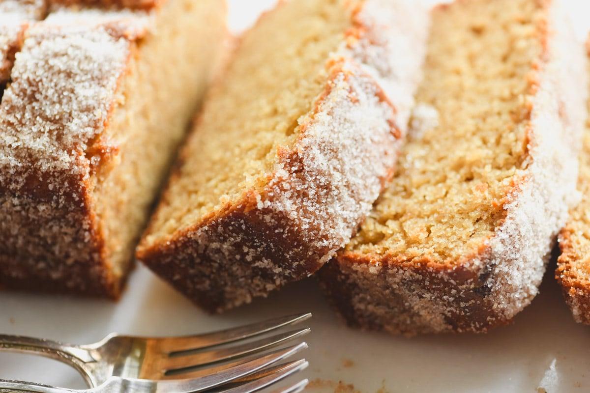 apple cider doughnut loaf cake, sliced, with forks