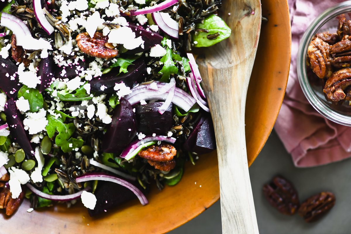 beet and wild rice salad topped with crumbled feta cheese