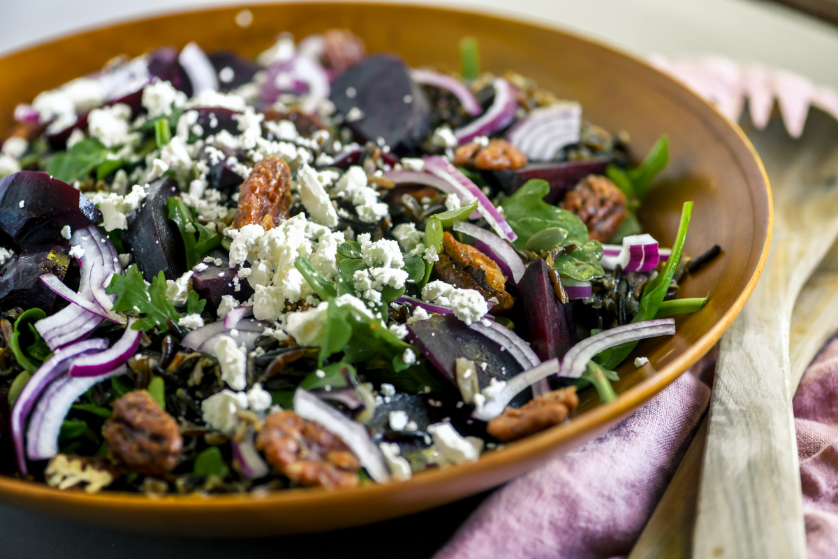 beet and wild rice salad in a wooden bowl