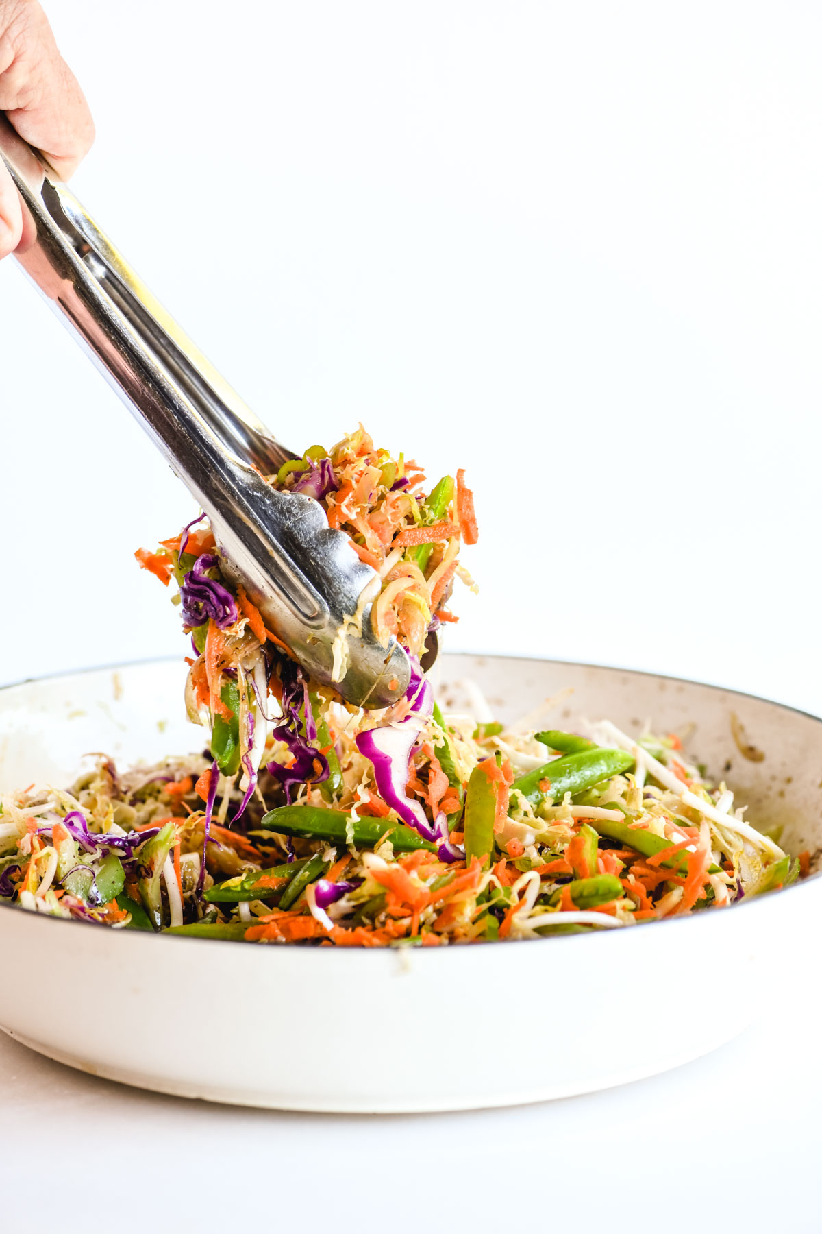 tossing egg roll bowl ingredients