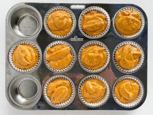 pumpkin muffin batter in muffin pan