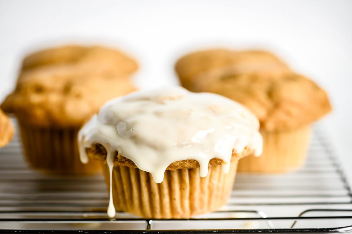maple glazed pumpkin muffins on a rack