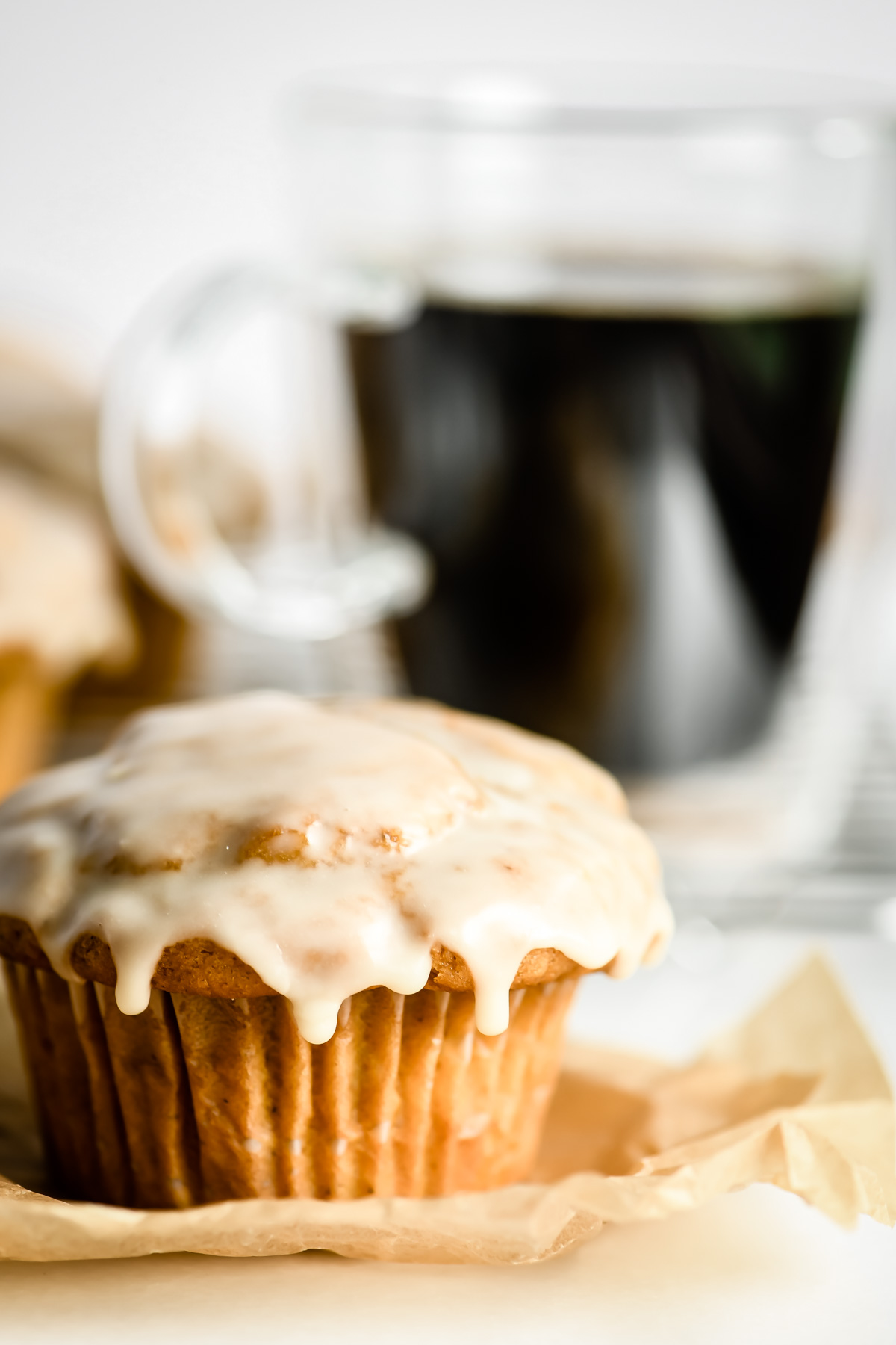 maple glazed pumpkin muffin with cup of coffee