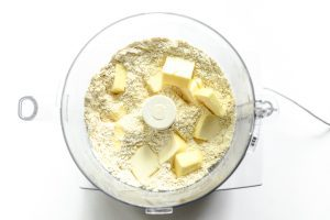 adding butter to biscuit mixture