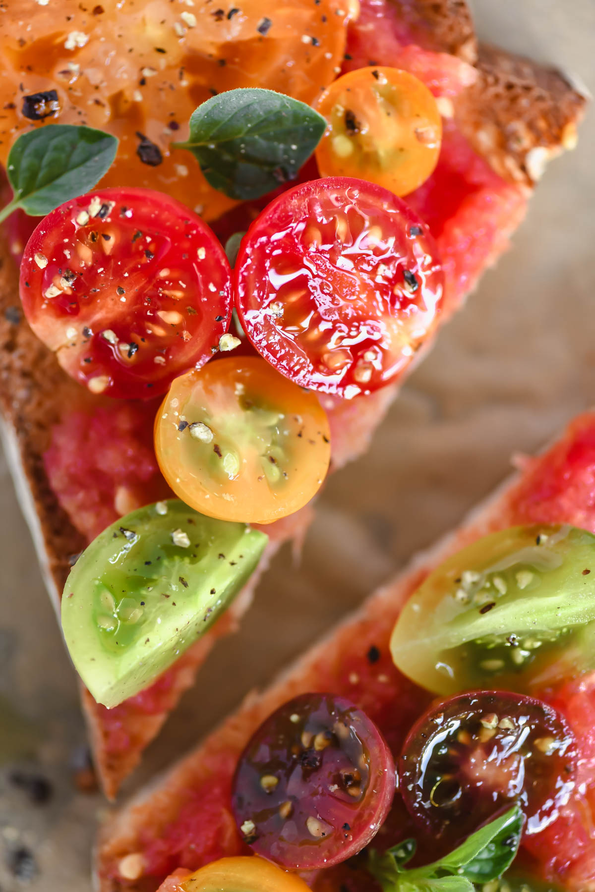sliced pan de tomate topped with colorful tomatoes