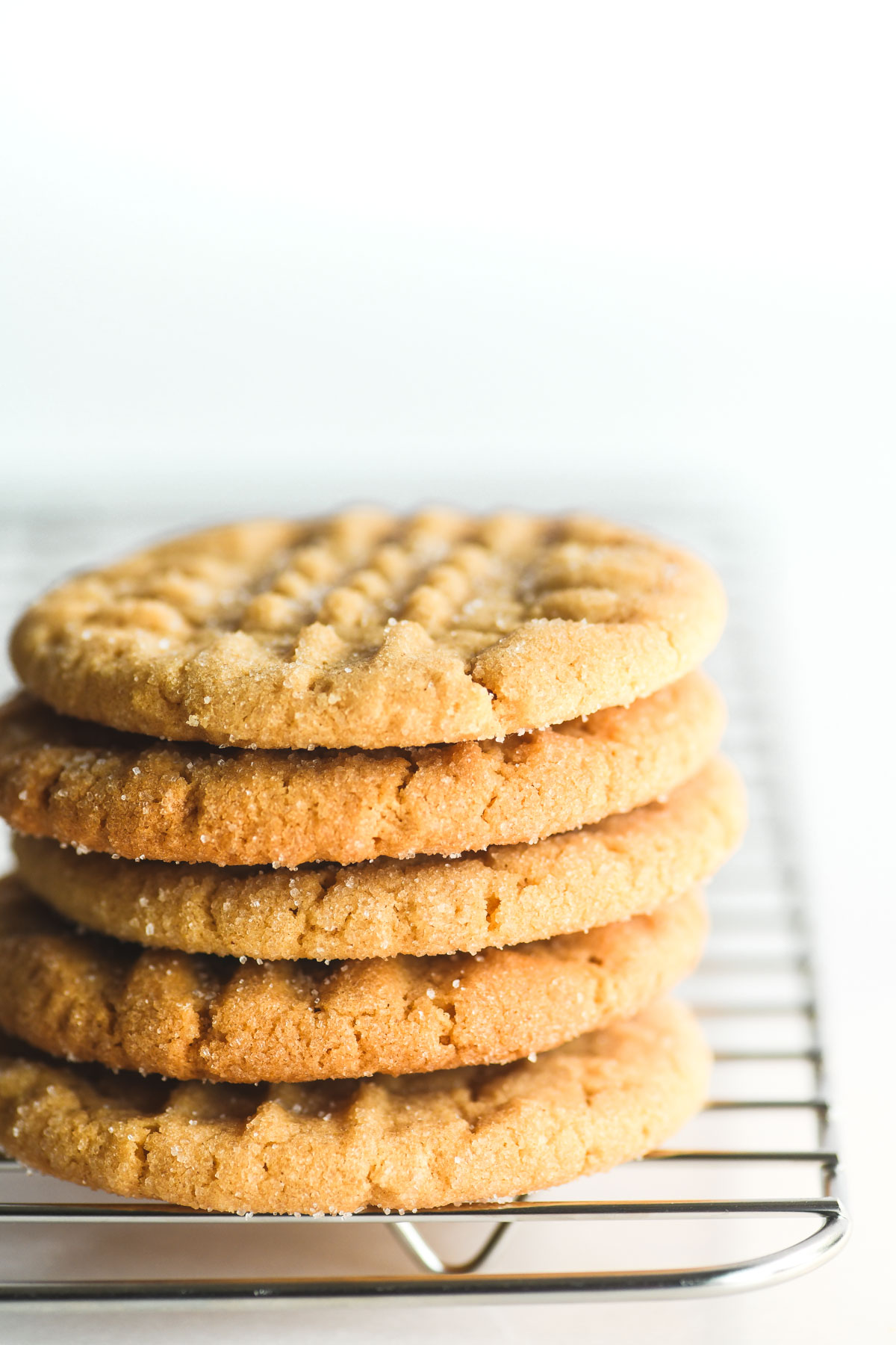 a stack of peanut butter cookies, on a rack