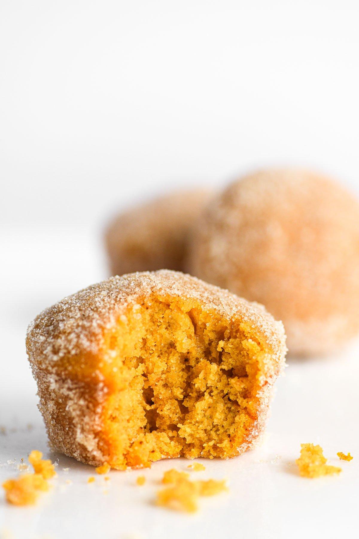 pumpkin doughnut muffin with bite taken out