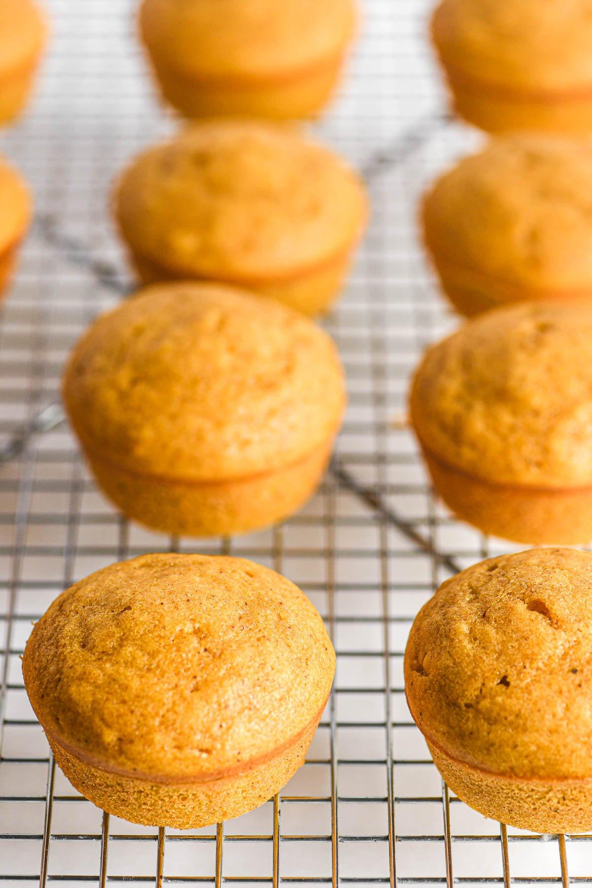 pumpkin doughnut muffins on a cooling rack